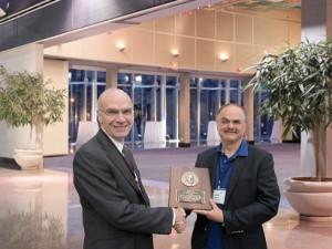 Ken Thibodeau presenting the 2012 Emmett Leahy Award to Dr. David Giaretta